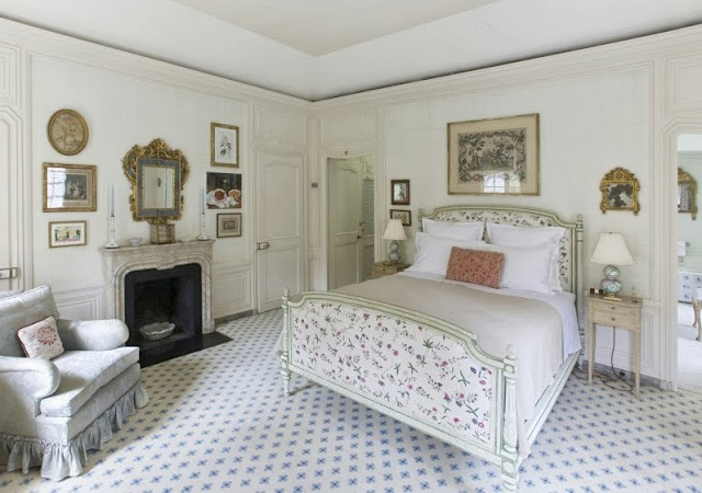 Bedroom in a NYC townhouse with Louis style bed and delicate floral patterns