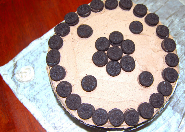 Vegan Chocolate Oreo Cake with vanilla buttercream and chunks of Oreo cookies | holycowvegan.net