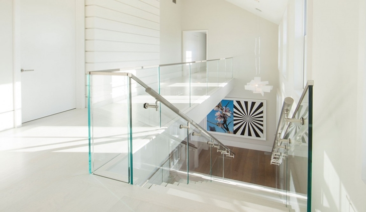 Glass stair fence in Contemporary style home on the beach