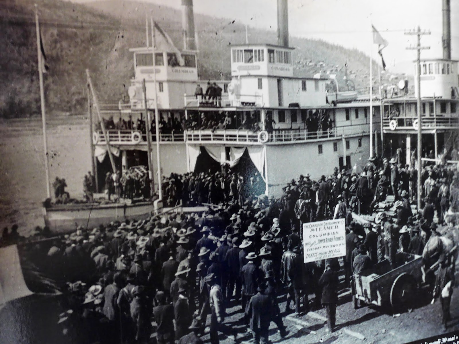 Old picture of people watching the ship arrive in the late 1800's