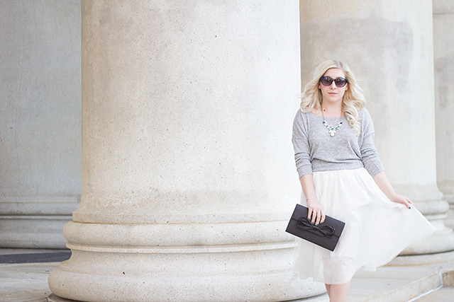 White tulle skirt with soft grey sweater & satin bow clutch // Fall outfit inspiration via Pretty Little Details