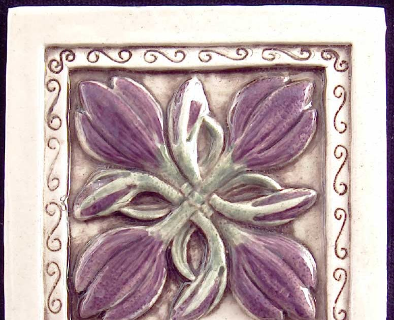 Decorative handmade ceramic tile relief carved