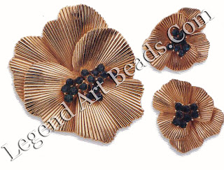 Pansy brooch and earring set by Boucher, dating from the 19405. The radial grooving on the petals is very typical of 194 OS Retro style. 05-95 ($145-160)