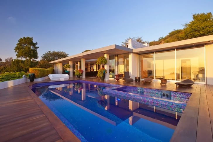Swimming pool in Renovated Beverly Hills House by Pablo Jendretzki