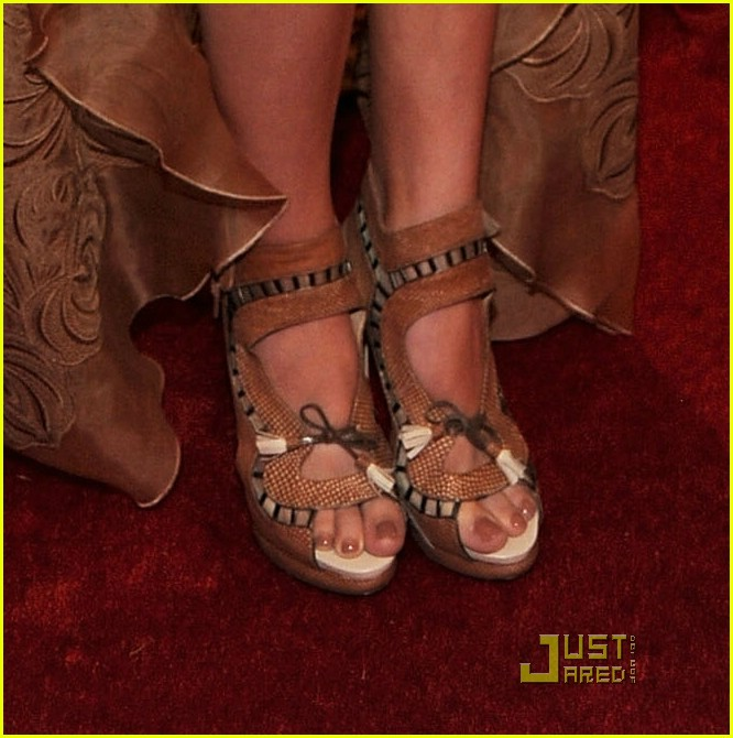 "The Nicholas Kirkwood bronze Lattice and Tassel-detailed sandals which Hailee Steinfeld paired with her gorgeous nude lace embroidered high-low Stella McCartney dress at the ""Alexander McQueen: Savage Beauty"" Costume Institute Gala held at The Metropolitan Museum of Art on May 2, 2011 in New York City."