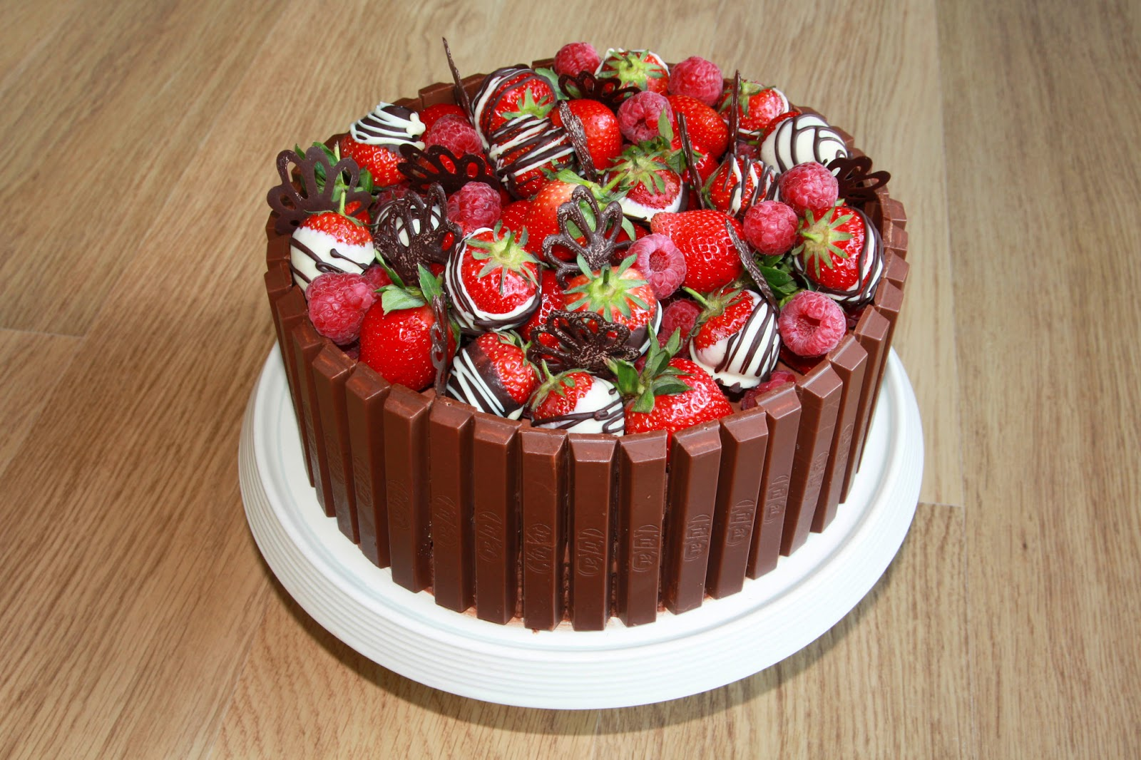 Chocolate And Raspberry Gateau Topped With Raspberries Dipped Strawberries