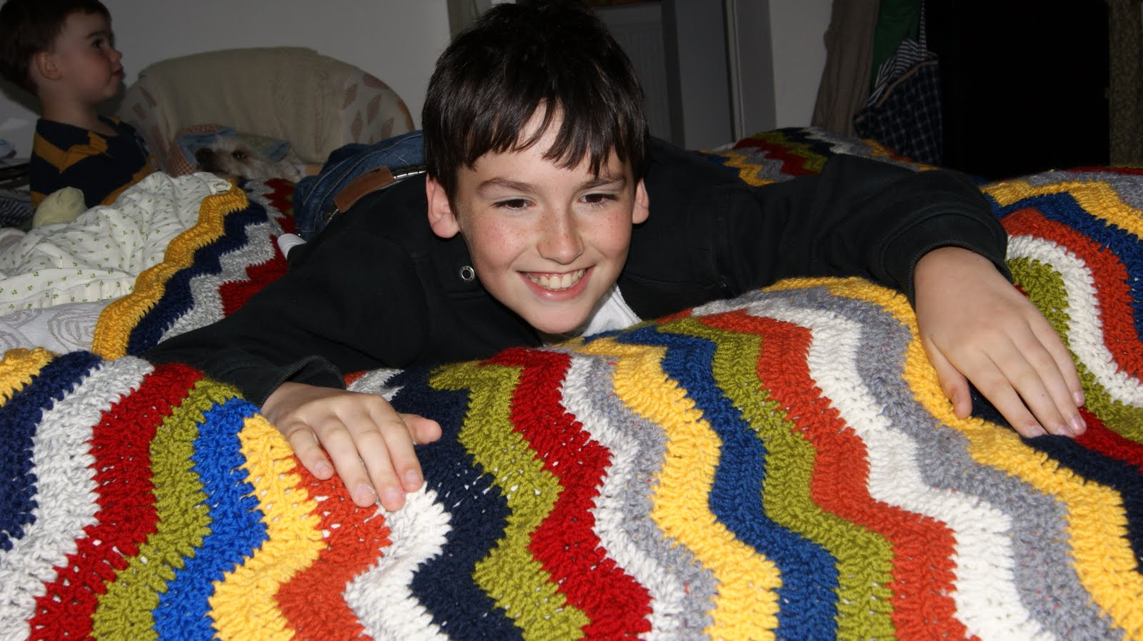 Ravelry: Ripple Blanket pattern by Bernat Design Studio