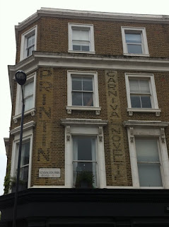 Ghost sign on Kensington Park Road, London W11