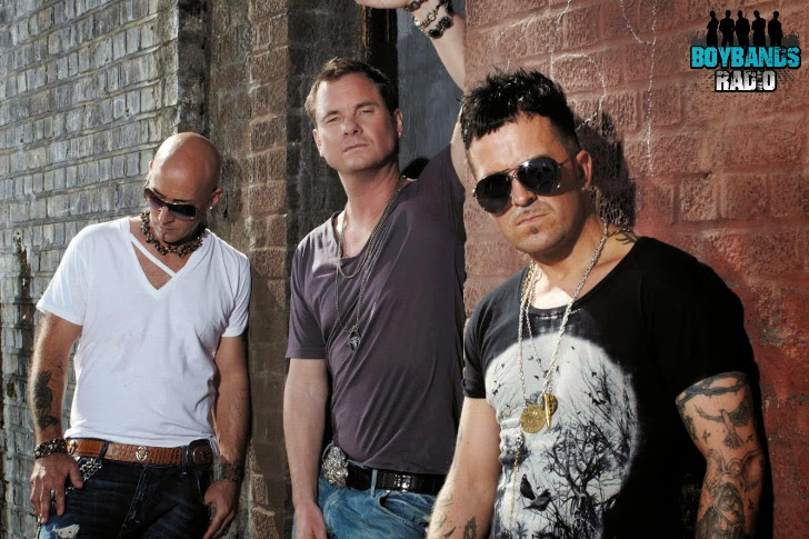 East 17 in one of the latest reincarnations as a trio. They were one of the biggest boybands in the 90s in the UK.