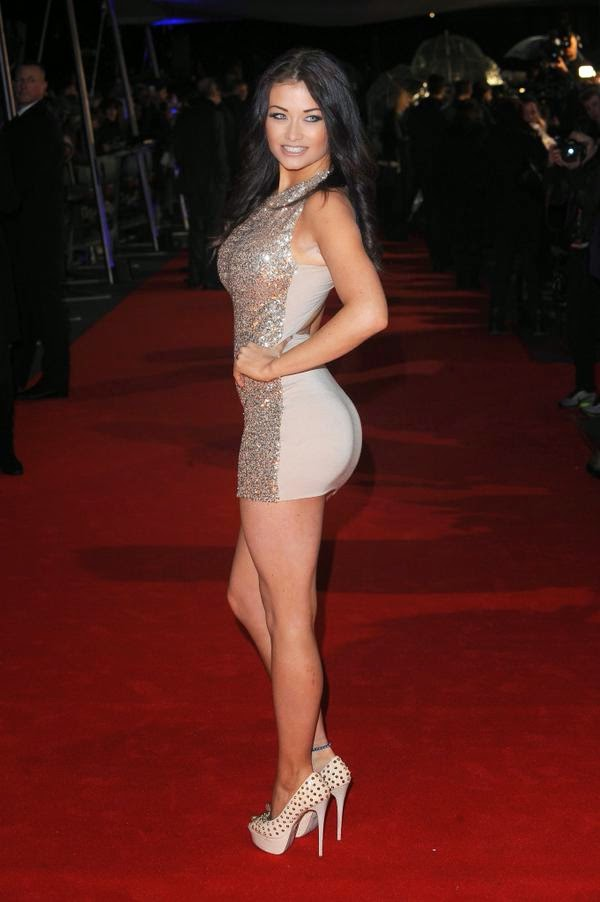 "Jess Impiazzi hot figure on red carpet at ""The Gunman"" Film premiere"
