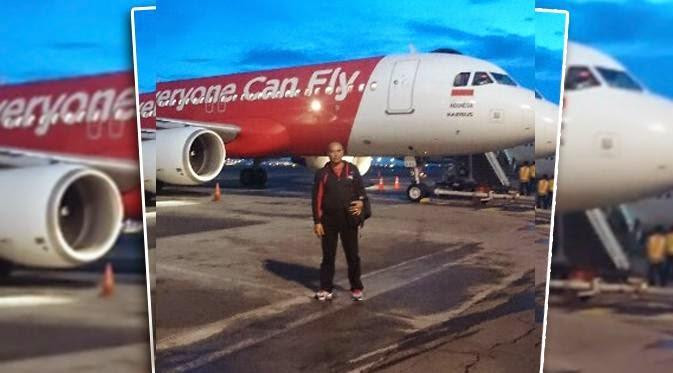 december 2014 hindu damaifoto gusti made bobby saat sebelum pesawat airasia berangkat (news liputan6 com)