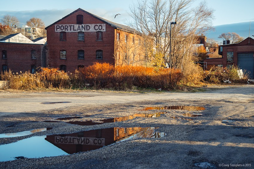 Portland, Maine November 2015 Photo by Corey Templeton. The reflection of the Portland Co. sign in a puddle along the Eastern Waterfront