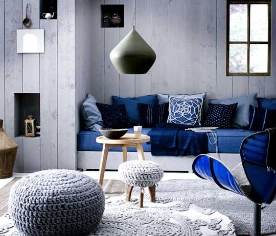 blue and grey living room with bench