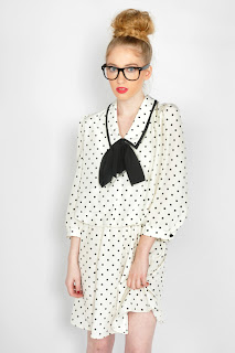 Vintage 1980's Diane Von Furstenberg white dress with black polka dots and a black bow at the neckline.
