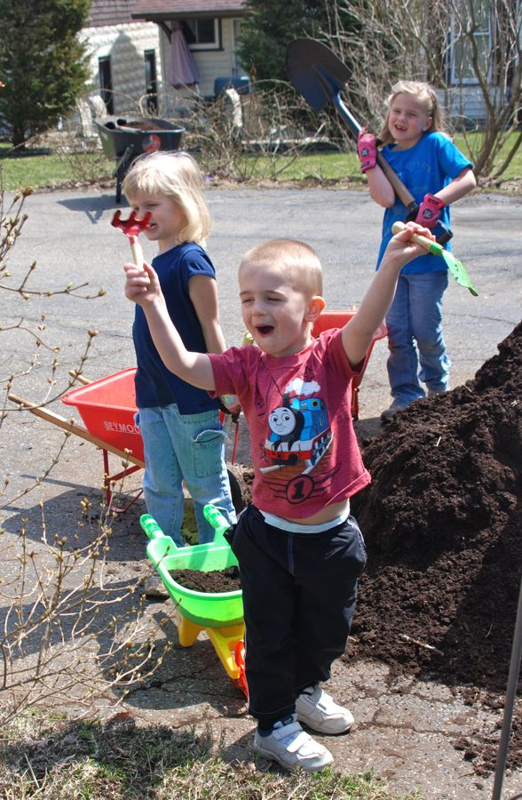 Mulching with kids in the garden