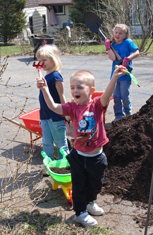 Mulching with kids in the garden