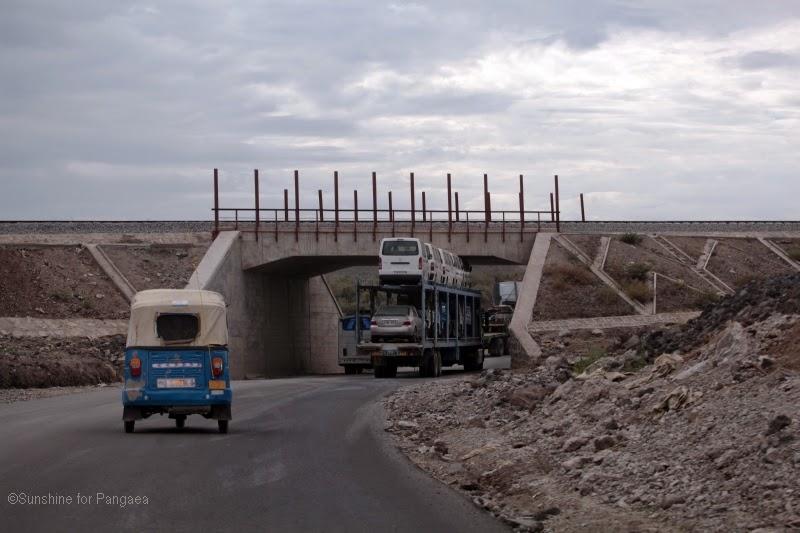 truck under a bridge
