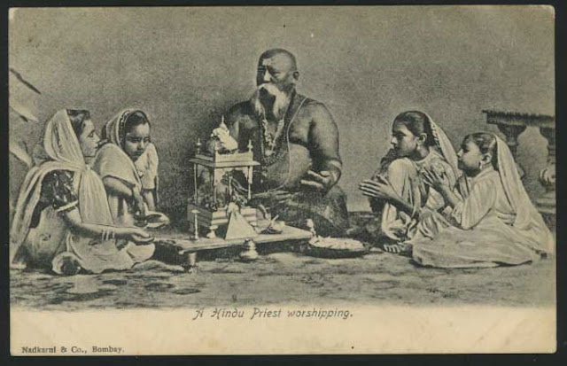 A-Hindu-Priest-Worshipping-God-with-Girls