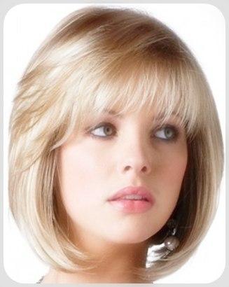 Model Rambut Pendek Ikal Mengembang