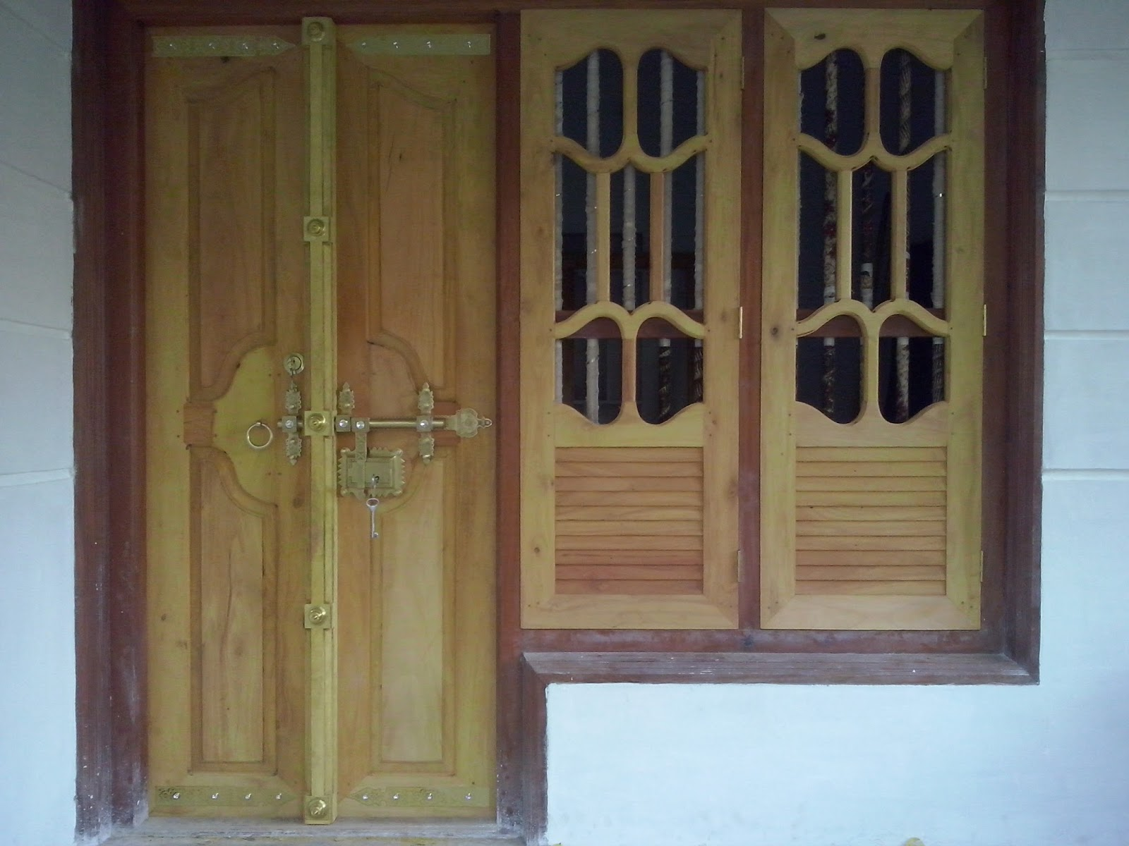 Kerala style carpenter works and designs front entrance for Wooden window design with glass