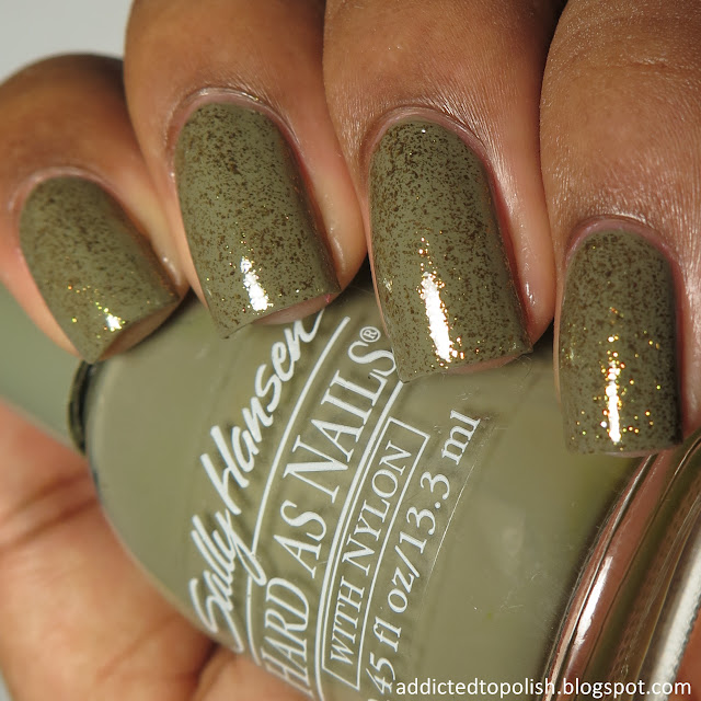 opi thrills in beverly hills top coat over sally hansen edgy creme