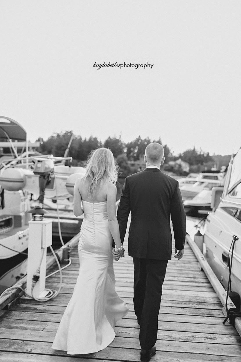 bride and groom walking away photo