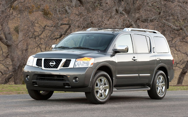 Front 3/4 view of gray 2011 Nissan Armada in front of bare trees