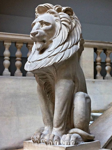 Carved stone lions guard the museum staircases