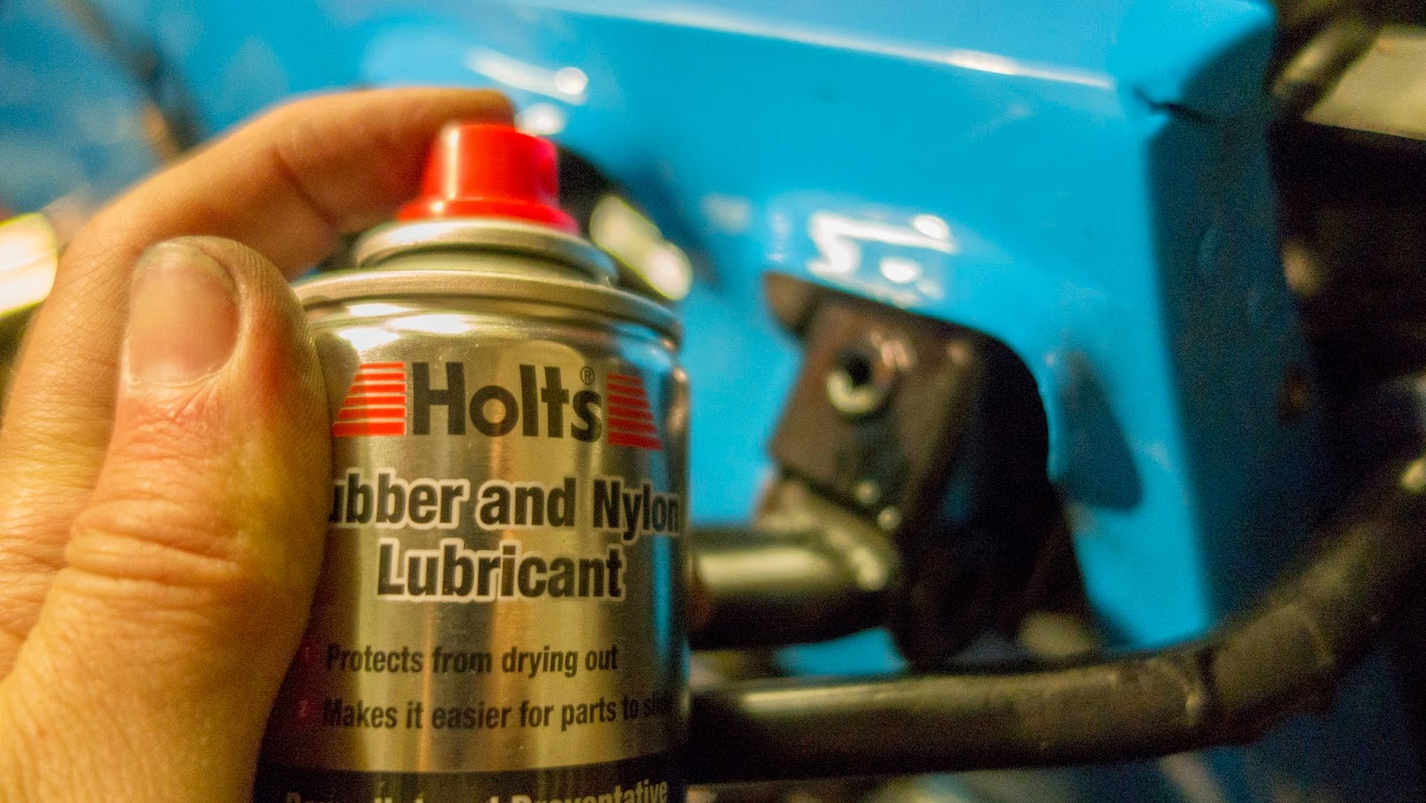 Apply a little Holts RL2R to the grommet in the upper wishbone mount