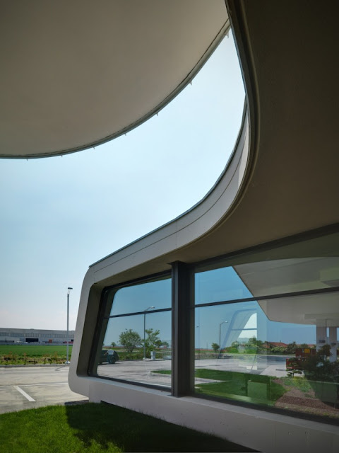 Window of the Gazoline Petrol Station by Damilano Studio Architects as seen from outside