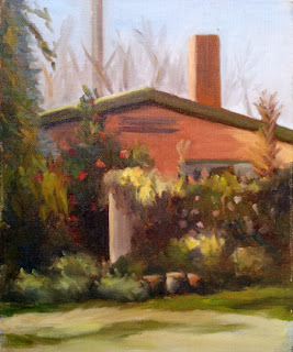 Oil painting of a building with a low-gabled roof and chimney, with a tall fence in the foreground overgrown with trees and shrubs.