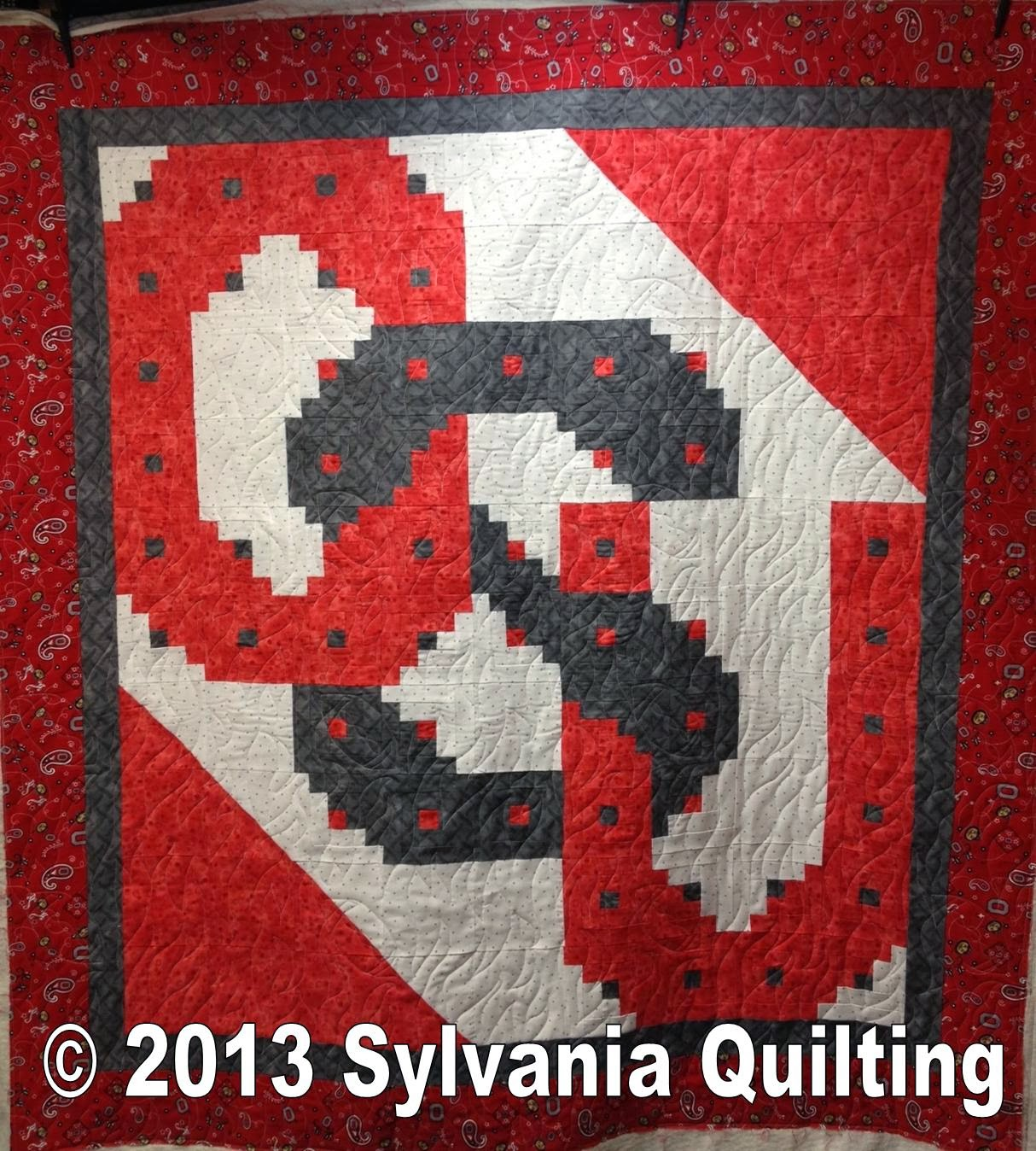 This Is A Close Up Of The Quilting On The Ohio State University Quilt . Full resolution  portraiture, nominally Width 1214 Height 1348 pixels, portraiture with #7F171A.