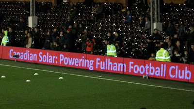 "A scrolling ad saying ""Canadian Solar: Powering Fulham Football Club."""