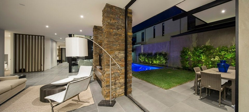 Stone and glass wall in Contemporary Higham Road Home in Melbourne