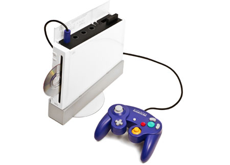 Photo of a Wii with purple GameCube controller attached