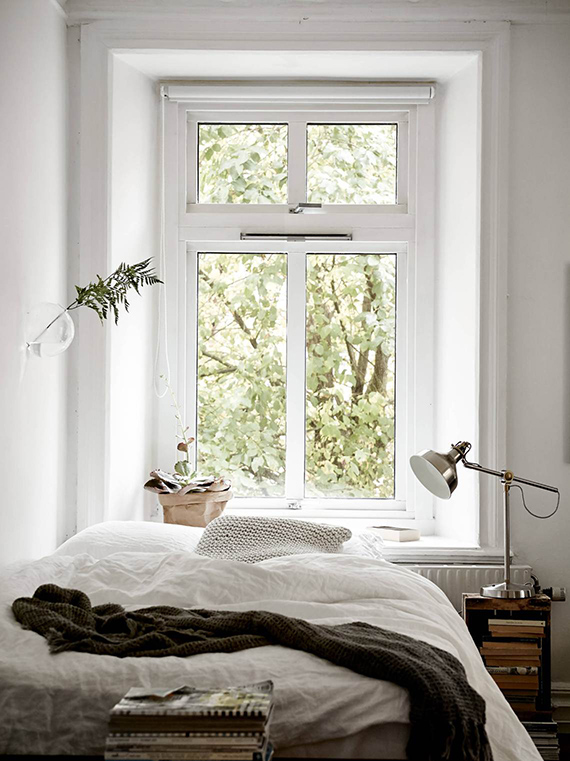 Cozy bed setting | Styling by Emma Fisher, photo by Janne Olander via Stadshem