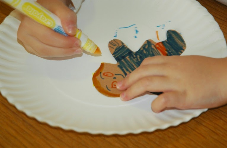 decorating gingerbread boys and girls for garland