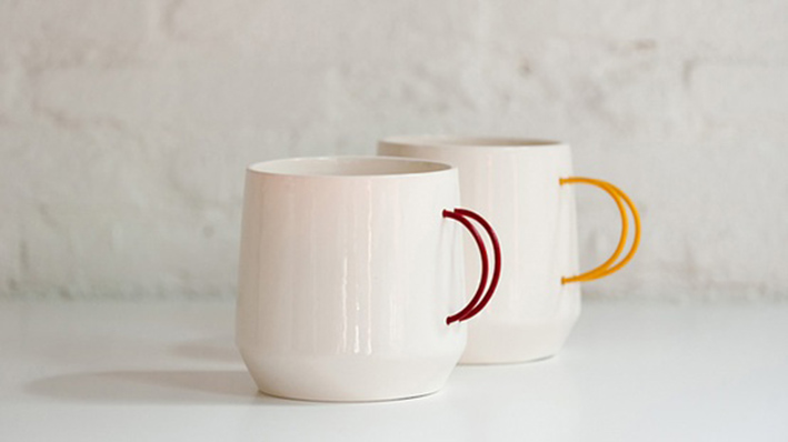 white cups with colourful handles