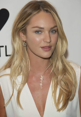 Candice Swanepoel beauty leg in a loose-fitting white dress
