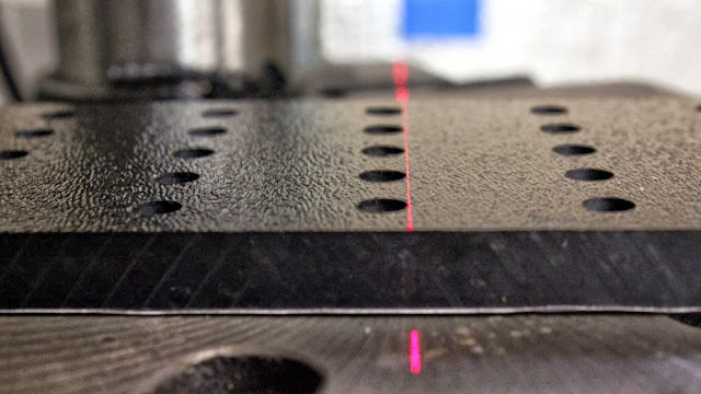 Alignment test of the camera stabilizer mounting holes, showing the high precision machining