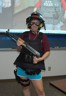 Student tries on gear used by the U.S. Marshal Service.