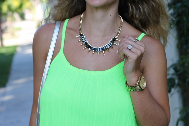 statement necklace with neon green outfit