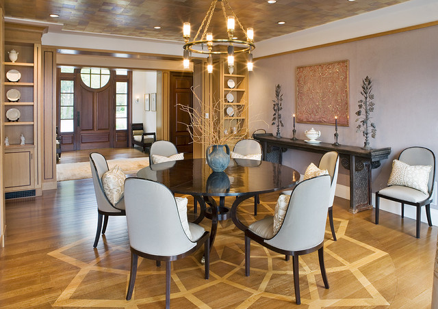 Simple Round Dining Tables in Dining Room with Grey Chairs and the Unique Ring Iron Chandelier