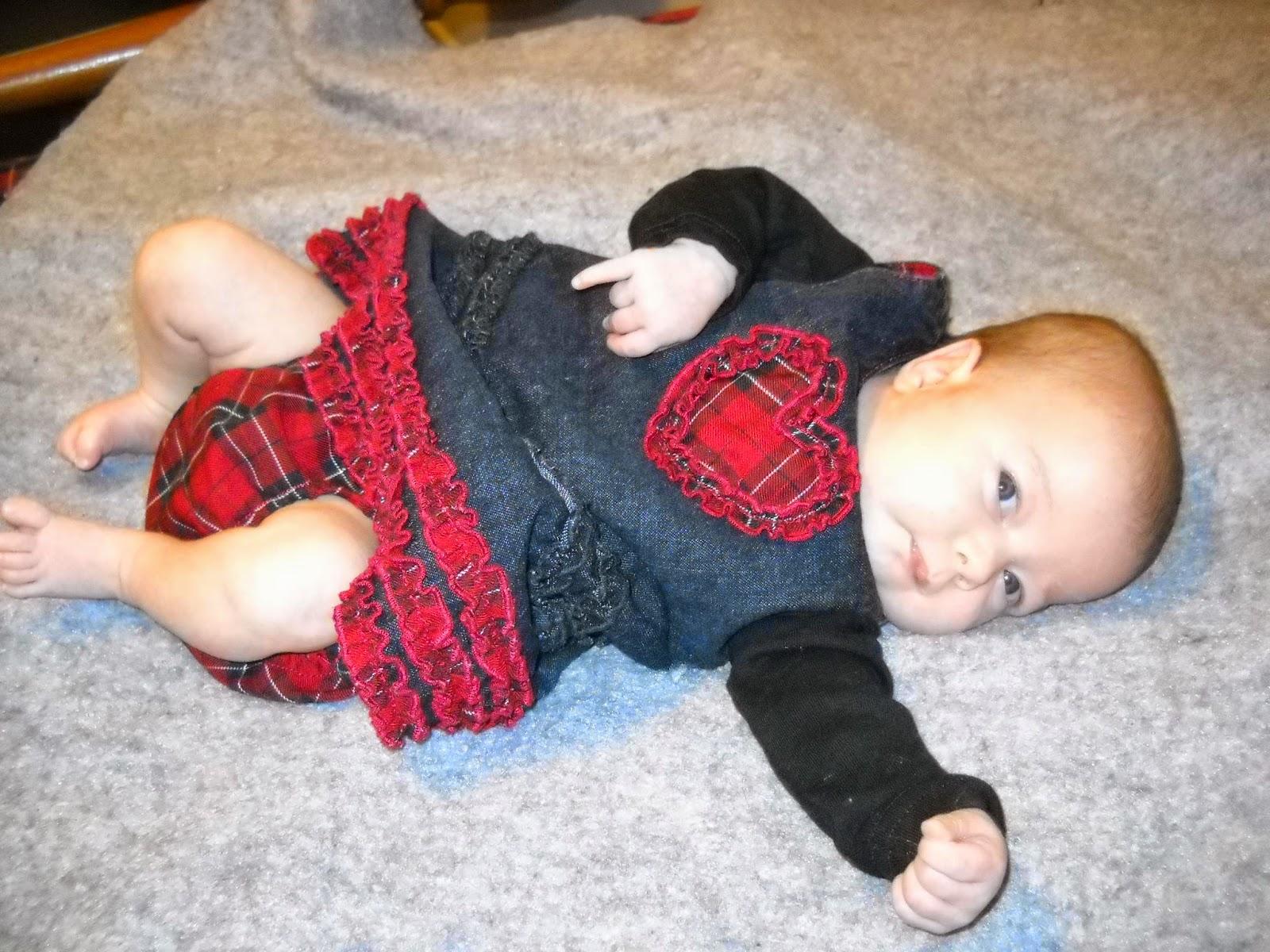 baby in heart jumper