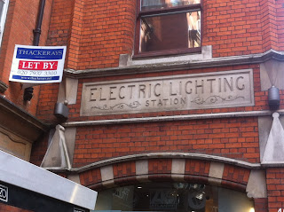 Old sign for an Electric Lighting Station, just of High Street Kensington, London