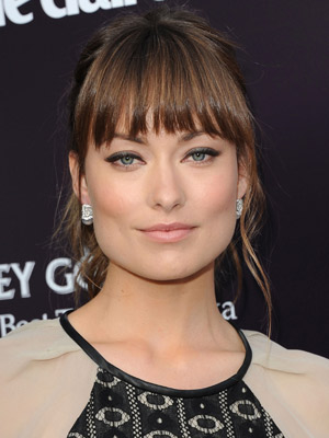 A brow-grazing fringe and loose pieces add sophistication to Olivia Wilde's perfect ponytail