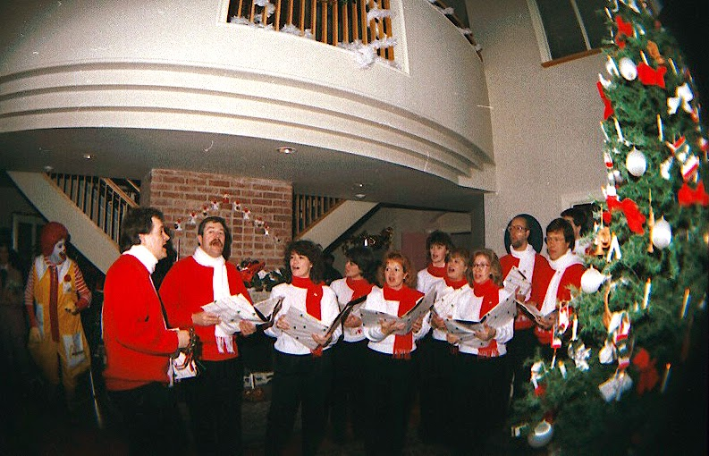 The Stairwell Carollers sing Christmas carols at Ronald McDonald House 1986