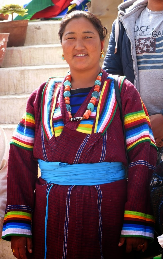 Woman wearing ethnic Tibetan dress and jewelry