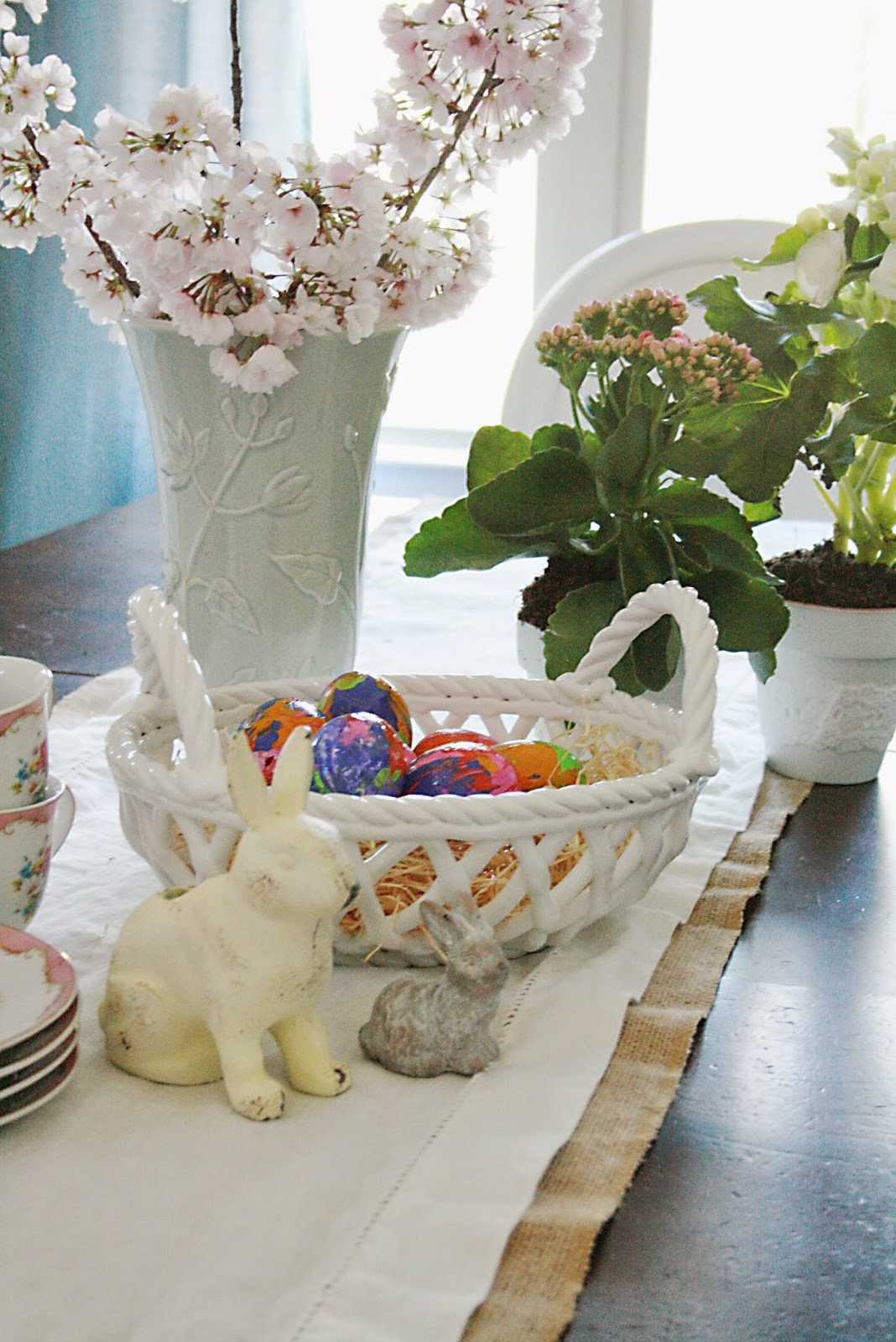 easter eggs decorating and table with spring flowers