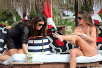 Brooke Vincent putting some sun sreen on her legs